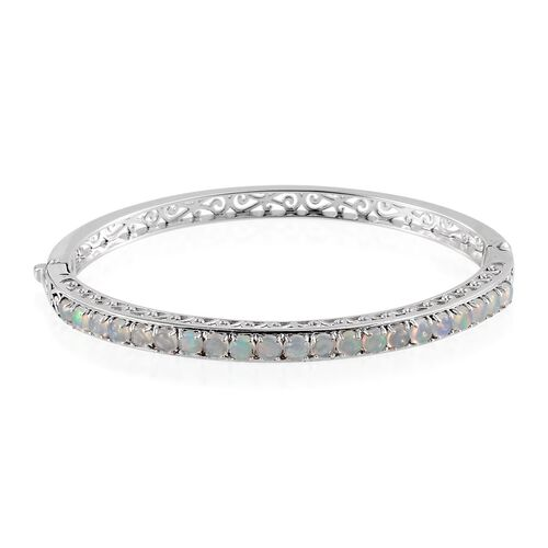 Ethiopian Welo Opal (Rnd) Bangle in Platinum Overlay Sterling Silver (Size 7.5) 6.000 Ct.