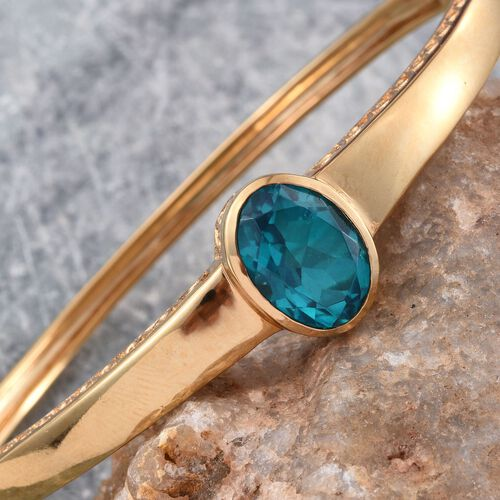 Capri Blue Quartz (Ovl) Bangle (Size 7.5) in ION Plated 18K YG Bond 6.000 Ct.
