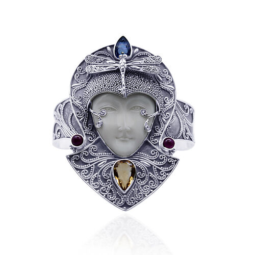 Princess Bali Collection OX Bone Carved Face (Ovl 15.00 Ct), Blue topaz, Ruby and Citrine Bangle in Sterling Silver (Size 7.5) 22.600 Ct.