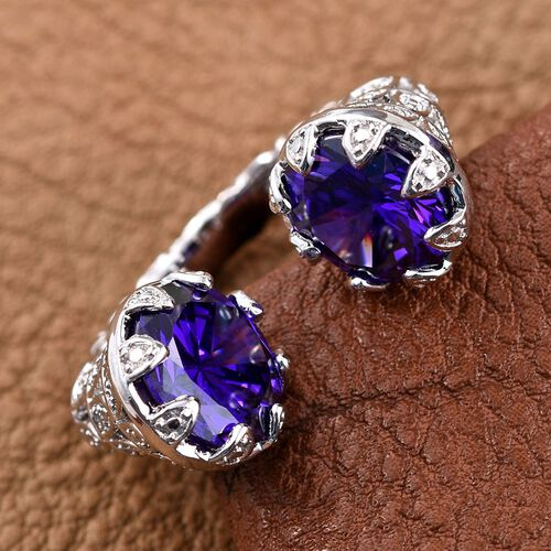 AAA Simulated Tanzanite (Rnd) Open Ring in ION Plated Platinum Bond