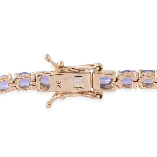 9K Yellow Gold 7.50 Ct. AA Tanzanite Tennis Bracelet (Size 7)