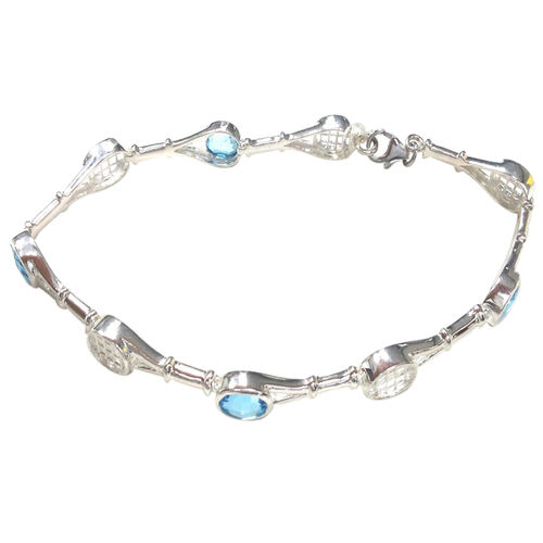 Limited Collection - Sky Blue Topaz (Ovl) Bracelet (Size 7.75) in Rhodium Plated Sterling Silver 4.000 Ct.