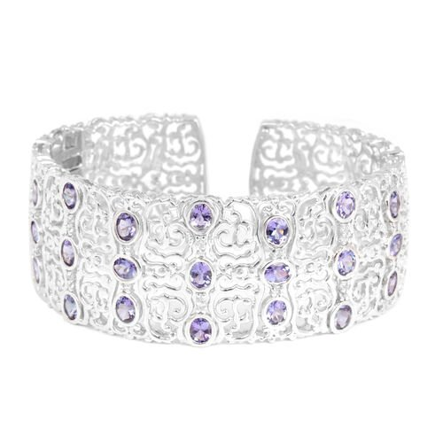 Tanzanite (Ovl), White Topaz Cuff Bangle (Size 7.5) in Platinum Overlay Sterling Silver 8.000 Ct. (Silver Wt. 39 Gms.)