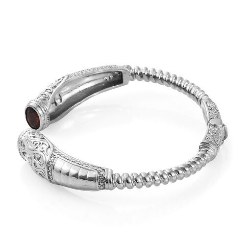 Designer Inspired- Mozambique Garnet (Ovl) Cuff Bangle (Size 7.50) in Platinum Plating l 2.500 Ct.