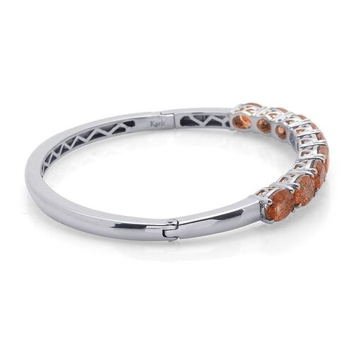 Tanzanian Sun Stone (Ovl) Bangle in Platinum Bond (Size 54x64MM- Medium) 9.000 Ct.