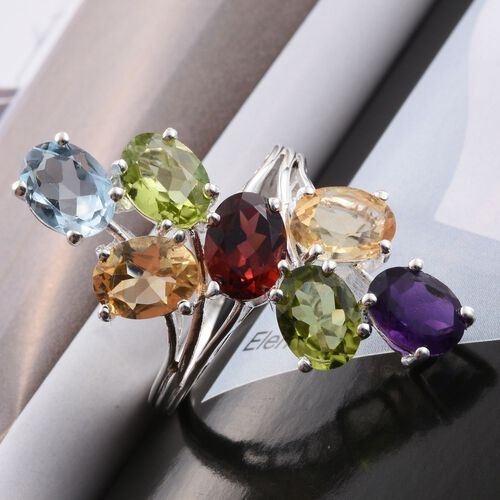 Mozambique Garnet (Ovl 1.25 Ct), Hebei Peridot, Citrine, Amethyst and Sky Blue Topaz Crossover Ring in Sterling Silver 8.750 Ct.