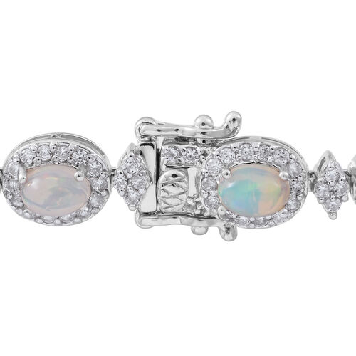 Ethiopian Welo Opal (Ovl), Natural White Cambodian Zircon Bracelet (Size 7.5) in Rhodium Plated Sterling Silver 11.250 Ct. Silver wt 18.00 Gms. Number of Gemstones 251