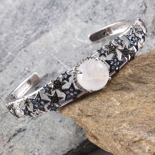 GP Rainbow Moonstone (Rnd 10.00 Ct), Kanchanaburi Blue Sapphire, Tanzanite, Natural Cambodian Zircon and Boi Ploi Black Spinel Cuff Bangle (Size 7.5) in Platinum Overlay Sterling Silver 12.250 Ct.
