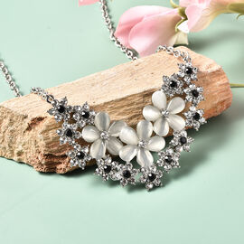 Simulated White Cats Eye, Black and White Crystal Floral Cluster Necklace (Size 20) in Silver Tone