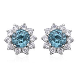 Ratnakiri Blue Zircon and Cambodian White Zircon Halo Stud Earrings in Rhodium Plated Silver