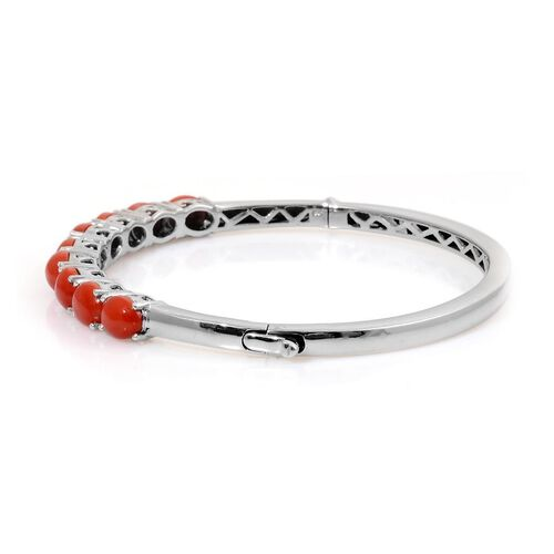 Natural Mediterranean Coral (Ovl) Bangle in Platinum Overlay Sterling Silver (Size 7.5) 6.750 Ct.