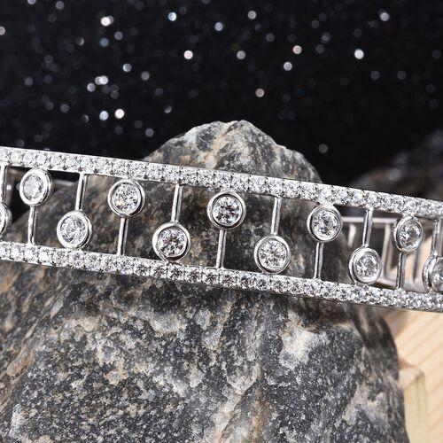 J Francis Platinum Overlay Sterling Silver (Rnd) Bangle (Size 7.5)  Made with SWAROVSKI ZIRCONIA, Silver wt 22.43 Gms.
