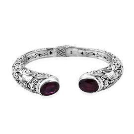 Royal Bali Collection - African Ruby (Ovl 14x10 mm) Cuff Bangle (Size 7) in Sterling Silver 14.64 Ct