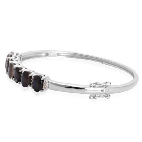 Canadian Ammolite (Ovl), White Topaz Bangle in Rhodium Plated Sterling Silver (Size 7.5) 6.400 Ct.