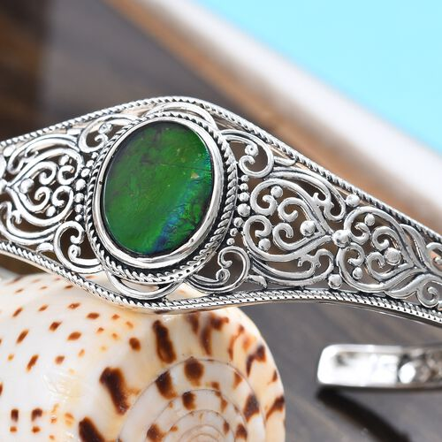 Canadian Ammolite (Ovl 16x12 mm) Bangle (Size 7.5) in Sterling Silver.Silver Wt 24.50 Gms