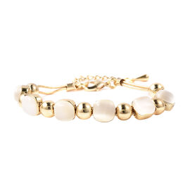 Simulated White Cats Eye Adjustable Beads Bracelet (Size 7-8) in Yellow Gold Tone
