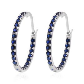 ELANZA Simulated Blue Sapphire Inside Out Hoop Earrings in Rhodium Plated Sterling Silver