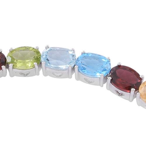 Mozambique Garnet (Ovl), Rhodolite Garnet, Swiss Blue Topaz, Amethyst, Citrine, Sky Blue Topaz and Hebei Peridot Bracelet (Size 7.5) in Rhodium Plated Sterling Silver 10.000 Ct. Silver wt 10.10 Gms.