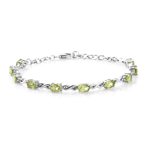 Hebei Peridot (Ovl) Bracelet (Size 6.50 with 1 inch Extender), Earrings (with Push Back), Pendant with Chain and Solitaire Ring in Platinum Overlay Sterling Silver 7.500 Ct. Silver wt 12.18 Gms.