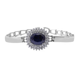 One Time Close Out Deal - Blue Sapphire (Very Rare Size Ovl 12x10 mm), Cubic Zircon  Cuff Bracelet (Size 7.5) in Rhodium Overlay Sterling Silver 6.770  Ct, Silver wt: 13.60 Gms
