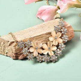 Simulated White Cats Eye, White Crystal Floral Cluster Necklace (Size 20) in Gold Tone