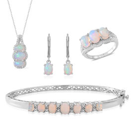 Ethiopian Welo Opal (Ovl) Ring, Bangle (Size 7.50), Pendant with Chain and Lever Back Earrings in Rhodium Plated Sterling Silver 6.000 Ct. Silver wt 18.50 Gms.