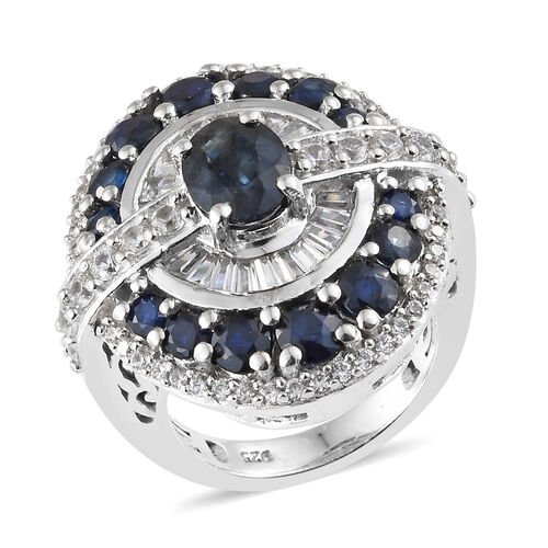 Designer Inspired - Kanchanaburi Blue Sapphire (Ovl), Natural White Cambodian Zircon Ring in  Platinum Overlay Sterling Silver Ring 5.750 Ct, Silver wt 10.53 Gms.