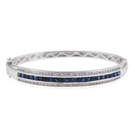 JCK Vegas Collection- AAA Madagascar Blue Sapphire (Princess), White Topaz Bangle (Size 7.25) in Rho