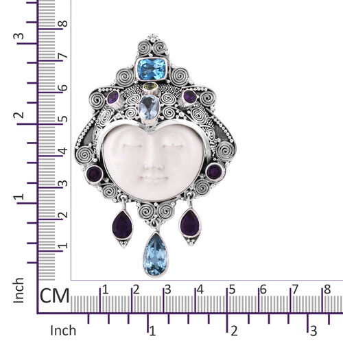 Princess Bali Collection OX Bone Carved Face(Rnd 18.000 Ct), Sky Blue Topaz, Amethyst,Blue Topaz and Hebie Peridot Pendant Cum Brooch in Sterling Silver  29.903  Ct, Silver wt 23 Gms.