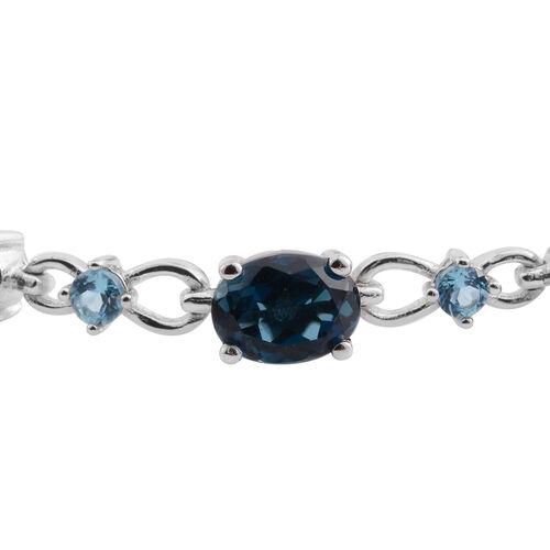 London Blue Topaz (Ovl), Swiss Blue Topaz and Diamond Bracelet (Size 7.5) in Rhodium Plated Sterling Silver 13.885 Ct. Silver wt 9.50 Gms.