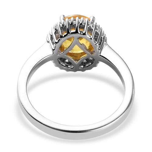 RHAPSODY 950 Platinum AAAA Loupe Clean Chanthaburi Yellow Sapphire (Ovl 9x7mm) and Diamond (VS/E-F) Halo Ring 2.65 Ct.