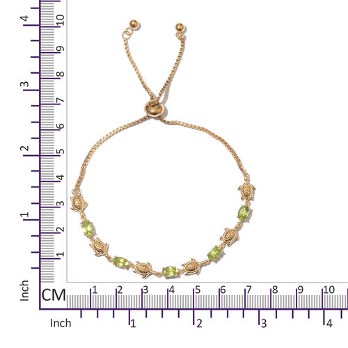 Designer Inspired- Hebei Peridot (Ovl) Bolo Adjustable Bracelet (Size 6.5 - 9.5) in Gold Tone