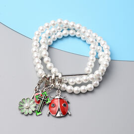 Set of 3 - White Shell Pearl Stretchable Enamelled Four Charm Bracelet in Silver Tone