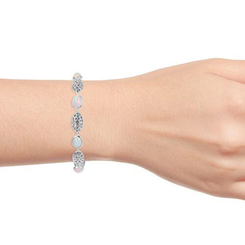 RACHEL GALLEY Ethiopian Welo Opal (Ovl 9x7 mm) Pebble Lattice Bracelet (Size 8) in Rhodium Plated Sterling Silver 4.650 Ct. Silver wt 12.90 Gms.