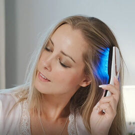 Opatra Advanced Skin Technologies - Lux Hairbrush - Using Light Therapy and Massage Therapy.