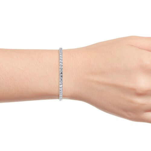 J Francis Platinum Overlay Sterling Silver (Rnd) Bangle (Size 7.5) Made with SWAROVSKI ZIRCONIA, Silver wt 14.90 Gms.