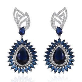 Simulated Blue Sapphire and Simulated Diamond Halo Drop Earrings in Silver Tone
