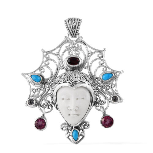 Queen Bali Collection OX Bone Carved Face, Mystic Pink Coated Topaz, Arizona Sleeping Beauty Turquoise, Mozambique Garnet and Blue Topaz Pendant in Sterling Silver 9.067 Ct. Silver wt 12.00 Gms.