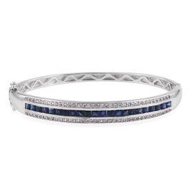 JCK Vegas Collection- AAA Madagascar Blue Sapphire (Princess), White Topaz Bangle (Size 7.25) in Rho