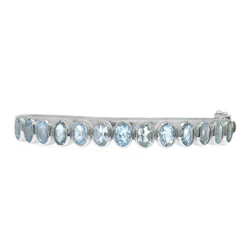 Hong Kong Close Out Deal Blue Topaz (Ovl) Bangle (Size 7.5) in Rhodium Plated Sterling Silver 6.000 Ct. Silver wt 19.50 Gms.