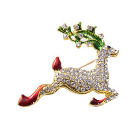 Christmas White and Black Austrian Crystal Reindeer Enamelled Brooch in Yellow Gold Tone