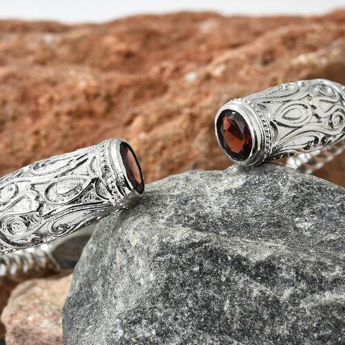 Designer Inspired- Mozambique Garnet (Ovl) Cuff Bangle (Size 7.50) in Platinum Plating l 2.500 Ct.